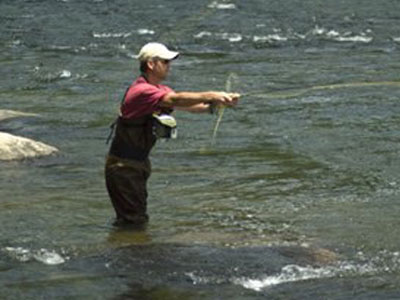 man fly fishing